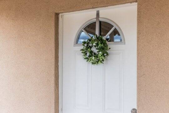The home's welcoming door.