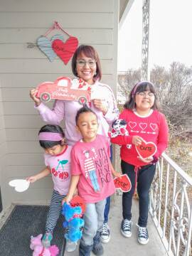 Cheryle with her 3 children at her new home.
