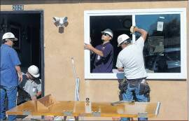MFA workers installing windows
