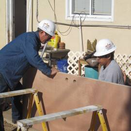 MFA working to weatherize a home